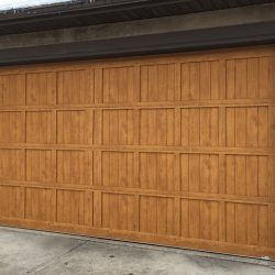 Insulated faux wood garage door