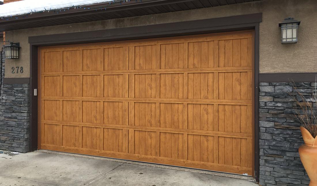 Insulated faux wood garage door